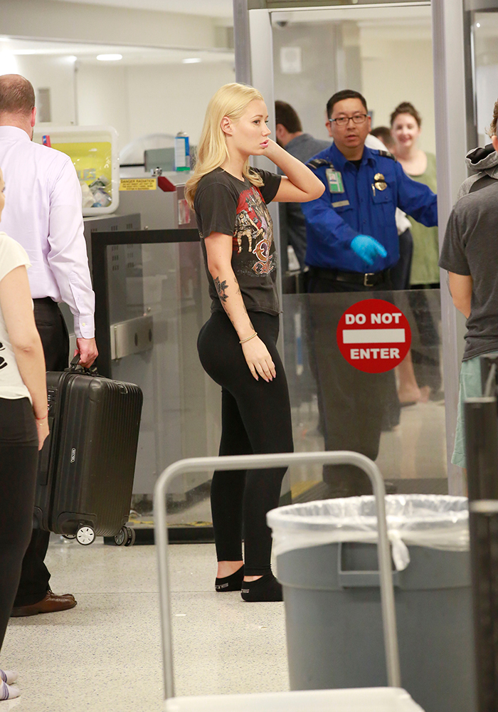 Photo © 2016 Splash News/The Grosby Group EXCLUSIVE September 12 2016 Iggy Azalea shows off her assets in tight spandex and an Ozzy Osbourne Tour tee-shirt as she catches a flight out of LA as French Montana dating rumors swirl. The adorable Australian rapper was seen at LAX going through TSA.